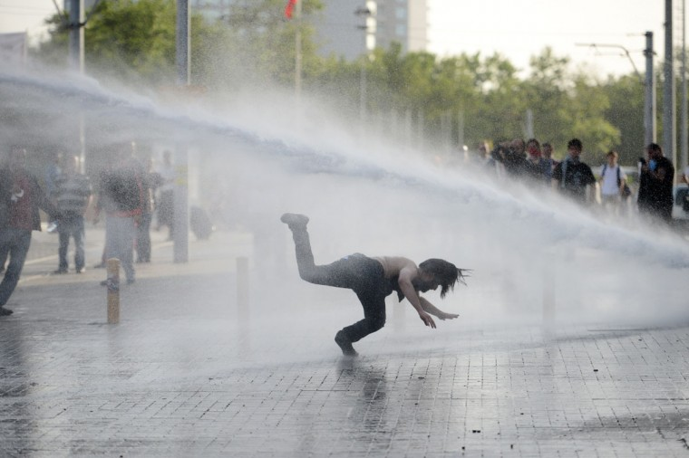Demonstrators flee from a water cannon during clashes with riot police during a protest against the demolition of Taksim Gezi Park, in Taksim Square in Istanbul. Police reportedly used tear gas to disperse a group, who were standing guard in Gezi Parki to prevent the Istanbul Metropolitan Municipality from demolishing the last remaining green public space in the center of Istanbul as a part of a major Taksim renewal project. Around 10 demonstrators have been wounded. (Stringer/AFP/Getty Images)