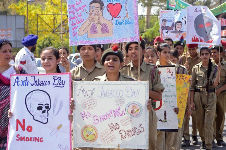 Indian National Cadet Corps (NCC) students hold up placards as they march during World No Tobacco Day in Amritsar. Governments worldwide must ban all forms of tobacco marketing, not just billboards and TV ads, as companies find new ways to tap the market, the World Health Organization said May 29. (Narinder Nanu/AFP/Getty Images)