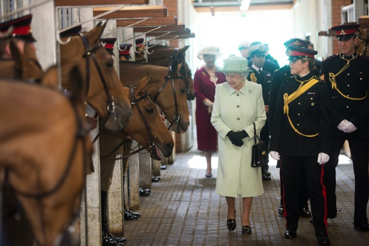 Britain's Queen Elizabeth II viewing the chargers and meeting members of The Kings Troop as she visits the King's Troop Royal Horse Artillery at Woolwich Barracks in south east London. Queen Elizabeth II marks the 60th anniversary of her coronation on Sunday, June 2, 2013 (Pool/Paul Grover/AFP/Getty Images)