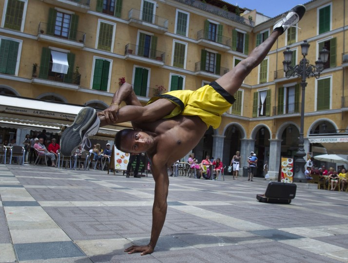 A Brazilian artist performs capoeira at Plaza Mayor square in Palma de Mallorca. (Jaime Reina/AFP/Getty Images)