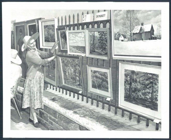 May 17, 1960: Mrs. Dorothy K. Mudgett hangs her art work of oil and water colors. (Edward Nolan/Baltimore Sun)