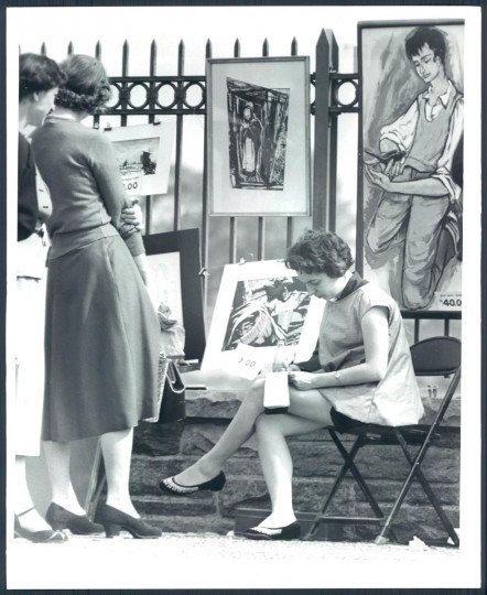 May 17, 1955: Mary Atherton with exhibit in background at the Baltimore Outdoor Art Festival. (Ellis Malashuk/Baltimore Sun)
