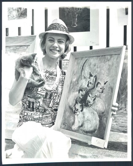 "May 21, 1962: Dede Scherer with her ""fur"" at the Baltimore Outdoor Art Festival at Druid Hill Park. She poses with Theodore, her cat. (Frank Gardina/Baltimore Sun)"