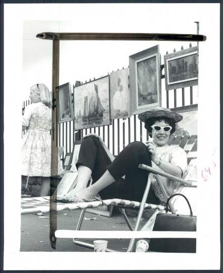 May 22, 1961: Lolly Garfield, one of many painters, sits and smiles to a passersby while her works hang on a railing around Druid Hill Lake. Although not a prize winner in yesterday's affair, she appears to have had a pleasant time. (Ralph Robinson/Baltimore Sun)