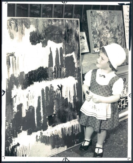 May 19, 1958: Diane St. Clair 2 yrs old seems puzzled over modernistic painting at the Baltimore Outdoor Art Festival. (Albert D Cochran/Baltimore Sun)