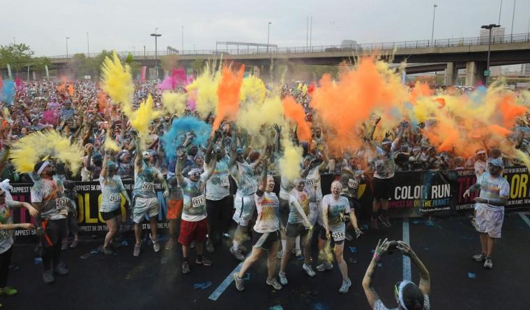 Runners celebrate at the inaugural Baltimore Color Run, held near the sports stadiums in downtown Baltimore. (Kenneth K. Lam/Baltimore Sun Photo)
