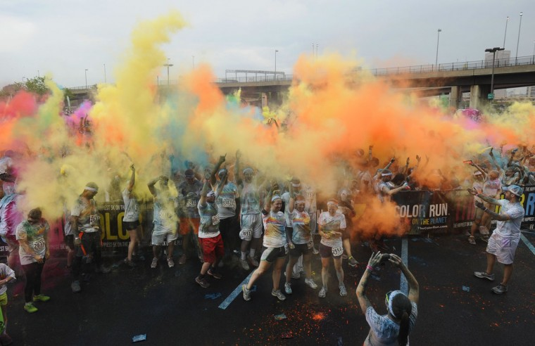 Runners celebrate with more color after finishing the inaugural Baltimore Color Run, which features some 25,000 runners and walkers in two runs around the stadiums in downtown Baltimore. (Kenneth K. Lam/Baltimore Sun Photo)