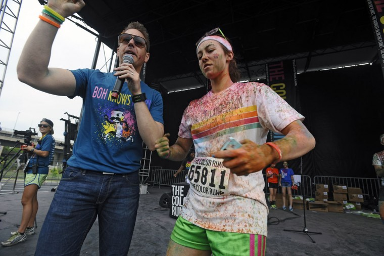 World champion figure skater Kimmie Meissner, right, who ran in the inaugural Baltimore Color Run, talks with race organizer Ryan Blanck, left, after the race. (Kenneth K. Lam/Baltimore Sun Photo)