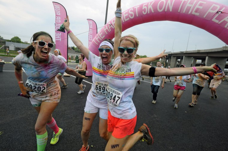 Participants run on the course of the first Baltimore Color Run, which featured some 25,000 participants in two runs around the sports stadiums in downtown Baltimore. (Kenneth K. Lam/Baltimore Sun Photo)