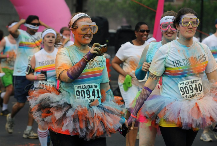 A runner takes pictures during the first Baltimore Color Run. (Kenneth K. Lam/Baltimore Sun Photo)