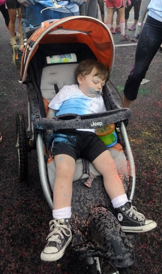 Tucker Deise, 18 months, needed a nap after finishing the first Baltimore Color Run in a stroller. (Kenneth K. Lam/Baltimore Sun Photo)
