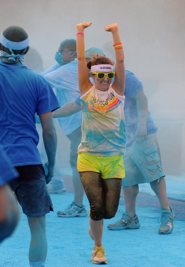 Runners get blue colored cornstarch thrown at them during the first Baltimore Color Run. (Kenneth K. Lam/Baltimore Sun Photo)