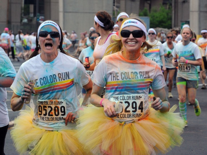 Runners in tutus run on the course of the first Baltimore Color Run, which featured some 25,000 participants in two runs around the sports stadiums in downtown Baltimore. (Kenneth K. Lam/Baltimore Sun Photo)