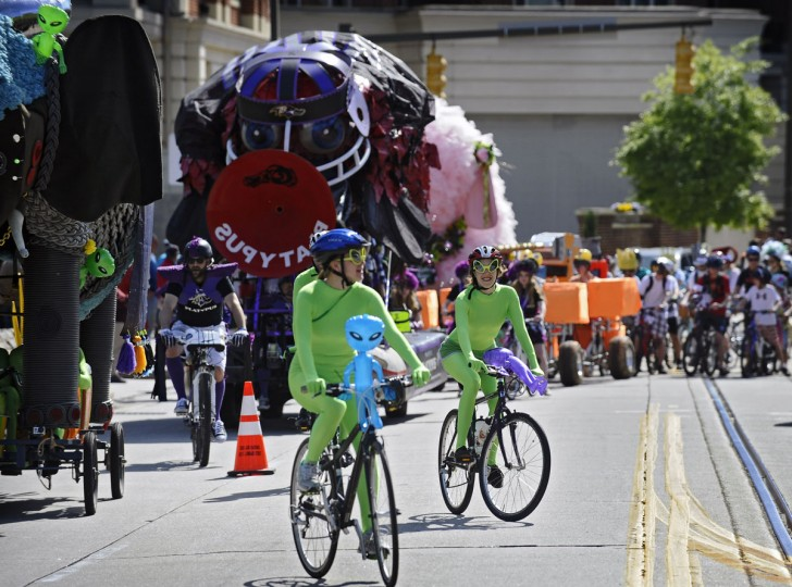 Cyclists of all ages and on all types of bikes peddle at the start of the 15th annual Kinetic Sculpture Race sponsored by the American Visionary Art Museum. (Kenneth K. Lam/Baltimore Sun Photo)
