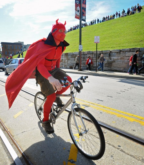 Rob Litchfield, of Baltimore, decided to dressed up as the devil and ride along with the participants of the 15th annual Kinetic Sculpture Race sponsored by the American Visionary Art Museum. (Kenneth K. Lam/Baltimore Sun Photo)