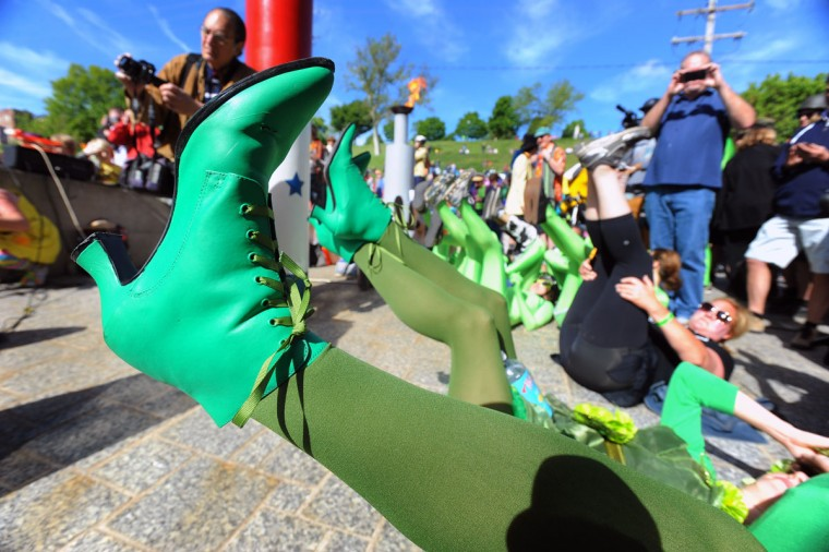 "Participants in the 15th annual Kinetic Sculpture Race, sponsored by the American Visionary Art Museum, get their feet ""blessed"" before the start of the race. (Kenneth K. Lam/Baltimore Sun Photo)"