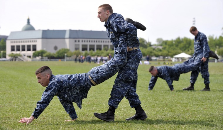 Plebes, fourth class midshipmen, are put through SeaTrials, a physical and mental challenge that promotes teamwork and company and class bonds at the United States Naval Academy. They are on Hospital Point, one of various stations located at the Academy and Naval Support Activity Annapolis. (Kim Hairston/Baltimore Sun)
