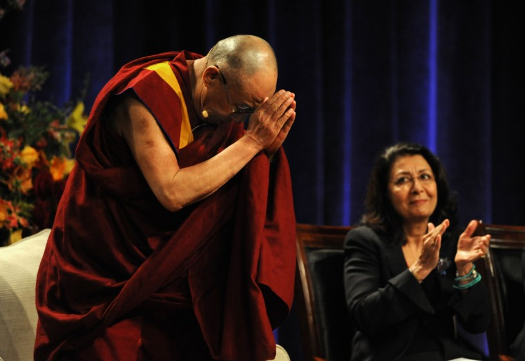 "His Holiness, the 14th Dalai Lama was the guest speaker at the Comcast Center for the Sadat Lecture: ""Peace Through compassion: Connecting a Multi-Faith World."" At right is Dr. Elahe Omidyar Mir-Djalali, founder and chair, Roshan Cultural Heritage Institute. (Algerina Perna/The Baltimore Sun)"
