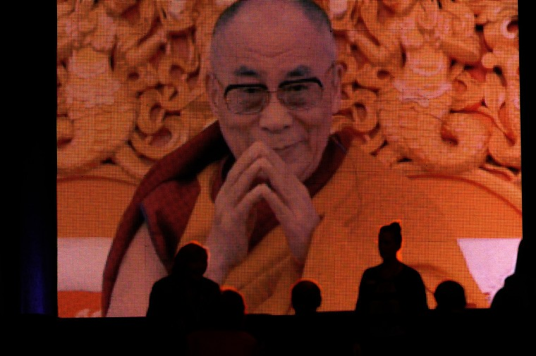 "A slide show is shown before the arrival of His Holiness, the 14th Dalai Lama at the Comcast He was the guest speaker for the Sadat Lecture: ""Peace Through compassion: Connecting a Multi-Faith World."" (Algerina Perna/The Baltimore Sun)"