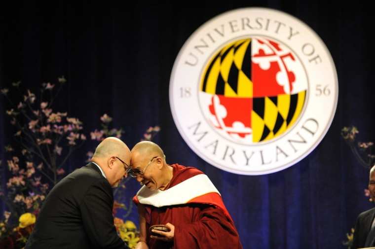 "His Holiness, the 14th Dalai Lama, right, was the guest speaker at the Comcast Center for the Sadat Lecture: ""Peace Through compassion: Connecting a Multi-Faith World."" He's thanking Dr. Shibley Telhami, left, the Anwar Sadat Professor for Peace & Development, after Telhami presented him with the commemorative artwork for the Satad Lecture for Peace, created by Mark Earnhard, titled, ""Tangible."" (Algerina Perna/The Baltimore Sun)"