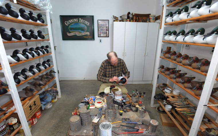Duck decoy maker Bryon Bodt works on painting some of his decoys. (Kenneth K. Lam/Baltimore Sun)
