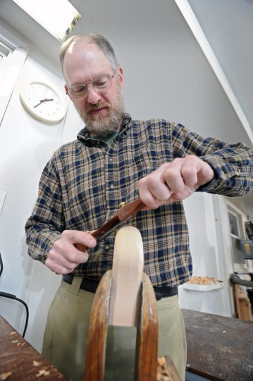 Bryon Bodt carves the rough shape of the head of a duck decoy at his home studio. (Kenneth K. Lam/Baltimore Sun)
