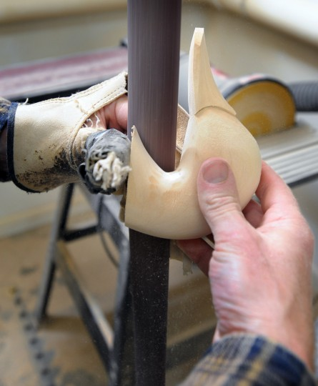 Duck Decoy maker Bryon Bodt uses a sanding pole to shape the head for a decoy. (Kenneth K. Lam/Baltimore Sun)