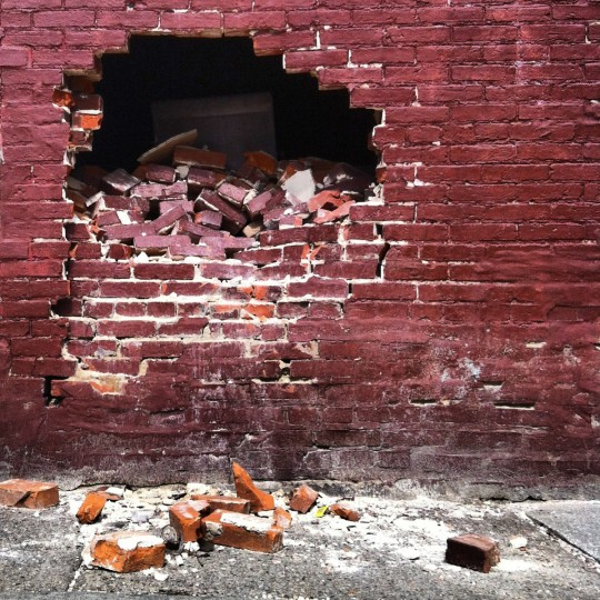 I found this hole in the side of a rowhome while trudging around the scene of a daytime shooting in West Baltimore. My imagination wandered trying to think what could have created such a hole. Commenters on this photo instantly thought of the Kool-Aid man. (Justin Fenton/Baltimore Sun)
