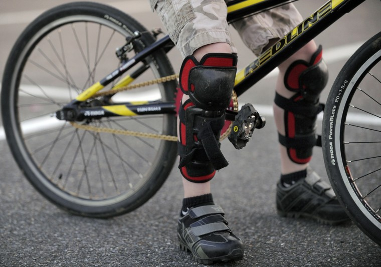Dylan Mulligan, 10, has his knee pads on as he prepares to head to the track for practice. (Gene Sweeney Jr./Baltimore Sun Photo)