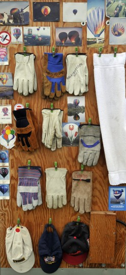Hot air balloon pictures, gloves, hats and a towel fill a door of the Kaleidoscope hot air balloon trailer. (Kim Hairston/Baltimore Sun)