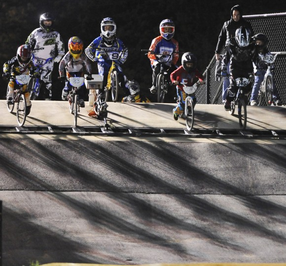 The gate drops and the riders try to catch their shadows as the lights take hold at the starting gate for the races. (Gene Sweeney Jr./Baltimore Sun Photo)