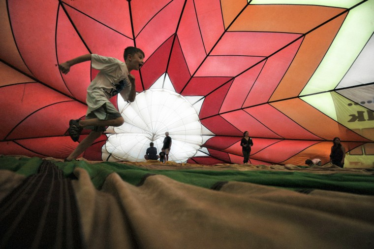 Children and adults explore the inside of a balloon. (Kim Hairston/Baltimore Sun)