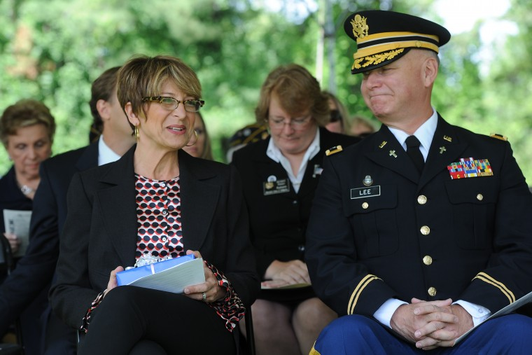 Lynn Coffland, president and founder of Catch A Lift Fund,sits with Col. Sean Lee, State Area Command Chaplain, Maryland National Guard, after she spoke at the Memorial Day Observance at Dulaney Valley Memorial Gardens. Catch A Lift Fund is an organization she started as a memorial to her brother, Cpl. Chris Coffland, who died in Afghanistan in 2009. (Kim Hairston/Baltimore Sun)
