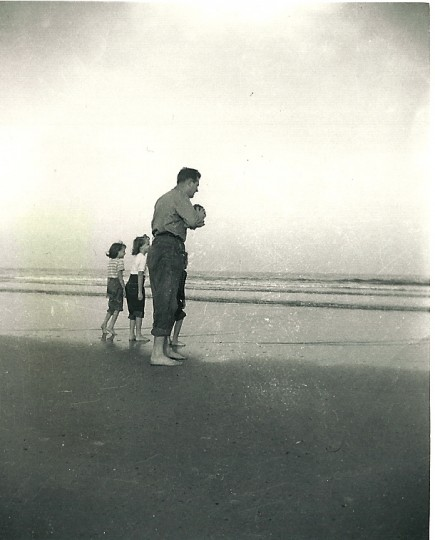 Moore plays with his children in the Atlantic Ocean. (Handout photo)