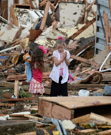 Children look at destroyed homes in the aftermath of a huge tornado that struck Moore, Oklahoma, Monday, May 20, 2013. (Gene Blevins/Zuma Press/MCT)