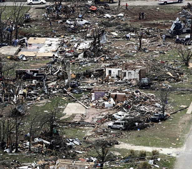 Debris from damaged homes litters the neighborhood on Thursday, May 16, 2013, in Granbury, Texas, after overnight storms sparked tornados and caused damage to the area. (Ron T. Ennis/Fort Worth Star-Telegram/MCT)