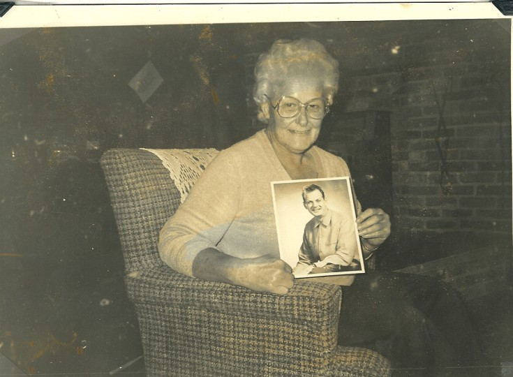 Mary holds a photo of her deceased husband, William. (Handout photo)