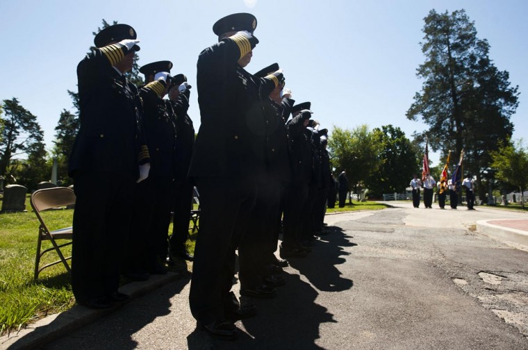 Fire fighters salute the flag at the start of the annual Memorial Day ceremony at Laurel's historic Ivy Hill Cemetery on Sunday, May 26, 2013. (Noah Scialom/Patuxent Publishing)