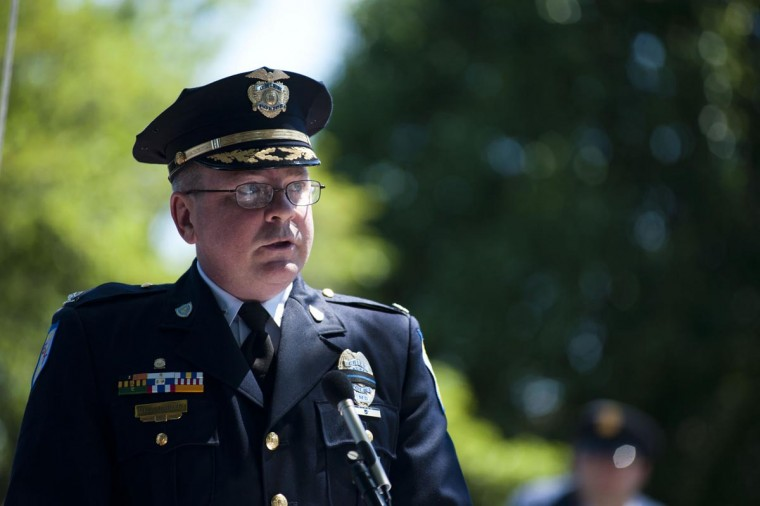 Laurel's Chief of Police Trey Kelso speaks at the podium during the annual Memorial Day ceremony at Laurel's historic Ivy Hill Cemetery on Sunday, May 26, 2013. (Noah Scialom/Patuxent Publishing)
