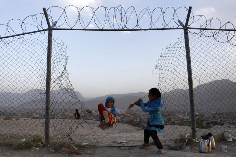 Afghan girls play in Kabul, May 20, 2013. (Mohammad Ismail/Reuters)
