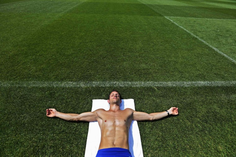 Olympic pole-vaulter champion Renaud Lavillenie of France rests on the infield at the Louis II Stadium in Monaco. Lavillenie, three-time Diamond League winner, trains for the start of the 2013 season which begins in June. (Eric Gaillard/Reuters photo)