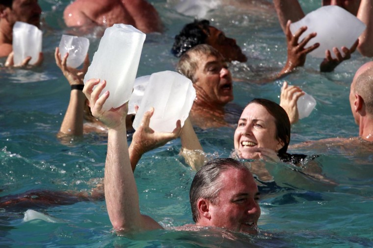 Members of the swimming club known as the Bondi Icebergs react as they hold blocks of ice during the launch of their winter swimming season at Sydney's Bondi Beach May 5, 2013. The annual event involves members of the Bondi swimming club holding blocks of ice as they jump into their salt-water pool. (David Gray/Reuters)