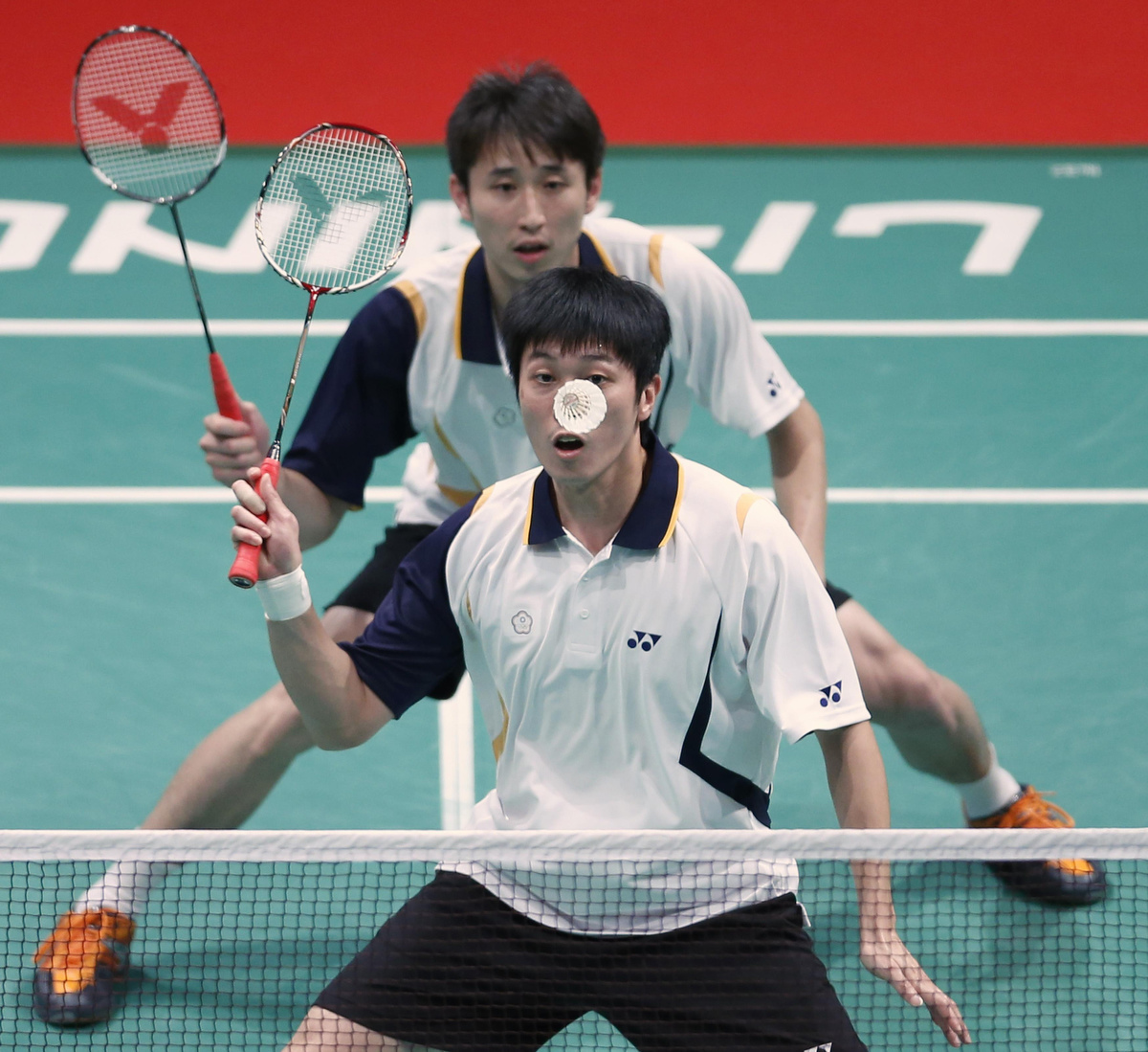 Taiwan s Tsai with partner Lee plays a shot during their men s