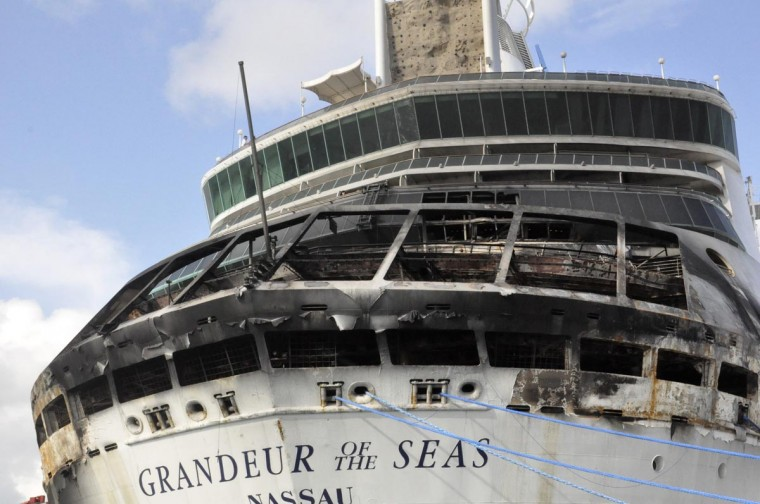 Damage on the Royal Caribbean ship Grandeur of the Seas is pictured as the ship is docked in Freeport May 27, 2013. A fire broke out on the ship's aft mooring deck in the early hours of Monday morning. The fire was extinguished at 0458 ET, and all 2,224 passengers and 796 crew members were safe and accounted for, according to the company. (Vandyke Hepburn/Reuters)