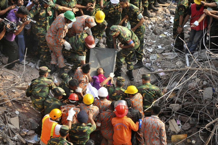 Rescue workers rescue a woman from the rubble of the collapsed Rana Plaza building, in Dhaka, Bangladesh, on May 10, 2013. The woman, identified by local media only as Reshma, was rescued on Friday after spending 17 days trapped under the rubble of a Bangladesh factory building that collapsed on April 24, killing more than 1,000 people, police and military officials said. (Sohel Ahmed/Reuters)