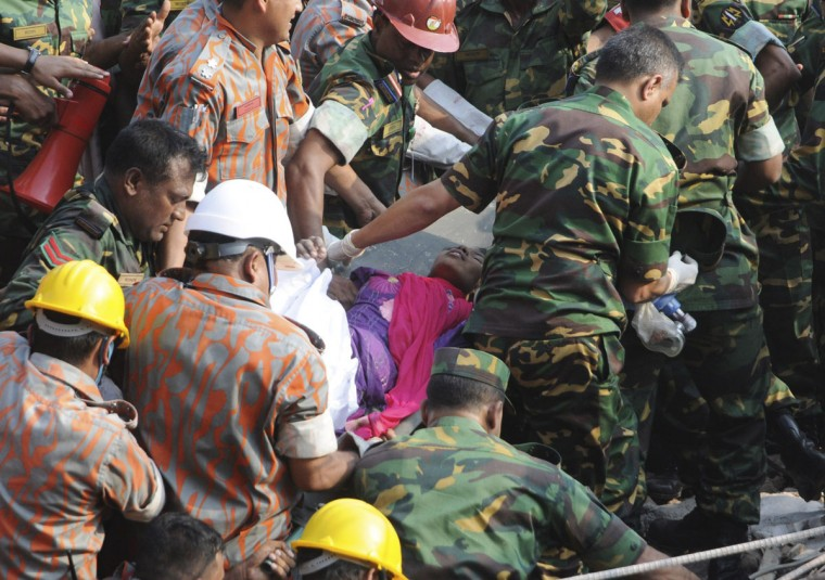 Rescue workers carry a woman from the rubble of the collapsed Rana Plaza building, in Dhaka, Bangladesh, on May 10, 2013. The woman, identified by local media only as Reshma, was rescued on Friday after spending 17 days trapped under the rubble of a Bangladesh factory building that collapsed on April 24, killing more than 1,000 people, police and military officials said. (Sanaul Huq/Reuters)