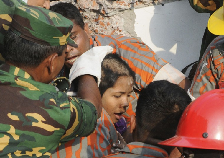 Rescue workers rescue a woman from the rubble of the collapsed Rana Plaza building, in Dhaka, Bangladesh, on May 10, 2013. The woman, identified by local media only as Reshma, was rescued on Friday after spending 17 days trapped under the rubble of a Bangladesh factory building that collapsed on April 24, killing more than 1,000 people, police and military officials said. (Sanaul Huq/Reuters)