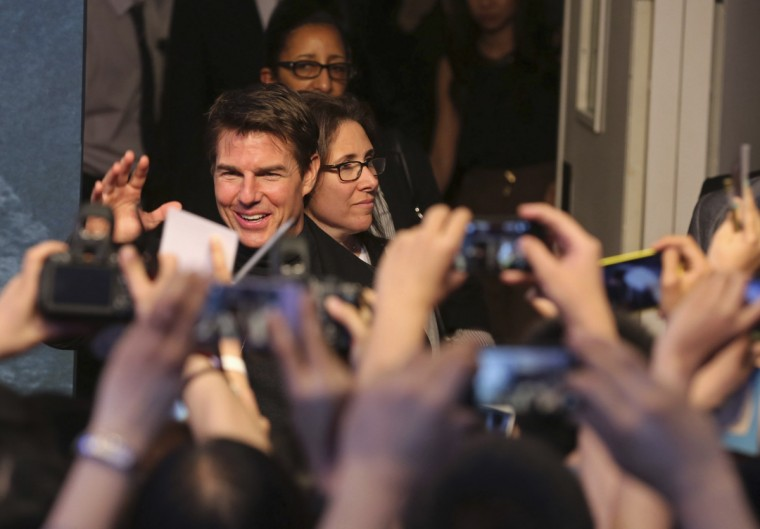 "People take pictures of of actor Tom Cruise as he attends a promotional event for his new movie ""Oblivion"" in Beijing, (REUTERS/China Daily)"