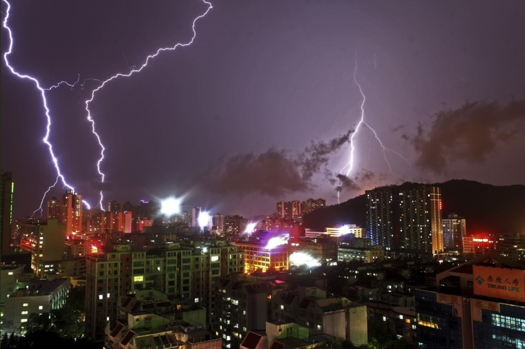 Lightning flashes in the sky in Zhuhai, Guangdong province. Heavy rainfall since Saturday has killed two people in south China's Guangdong Province, bringing the death toll resulting from rainstorms to 36 this year. (Reuters stringer)