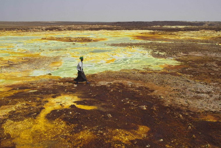 A man walks on sulphur and mineral salt formations near Dallol in the Danakil Depression, northern Ethiopia April 22, 2013. The Danakil Depression in Ethiopia is one of the hottest and harshest environments on earth, with an average annual temperature of 94 degrees Fahrenheit (34.4 Celsius). For centuries, merchants have travelled there with caravans of camels to collect salt from the surface of the vast desert basin. The mineral is extracted and shaped into slabs, then loaded onto the animals before being transported back across the desert so that it can be sold around the country. (Siegfried Modola/Reuters)